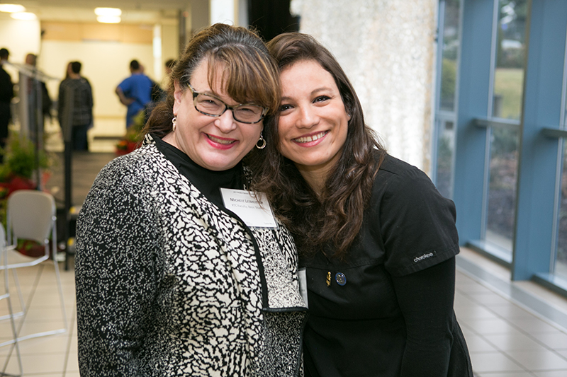 Photo of Michele Lesmeister and Sarra Ghezzaz, former ESL student who is about to graduate as a dental assistant.