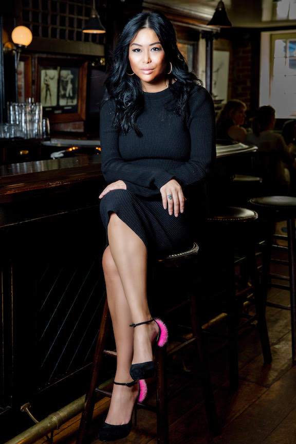 Photo of Angie Mar sitting at bar of Beatrice Inn by Eric Vitale