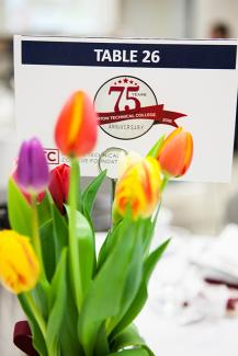 Photo of tulips and 75th Anniversary table sign.