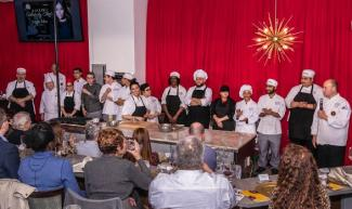 Celebrity chef dinner guests applaud Angie Mar and RTC students
